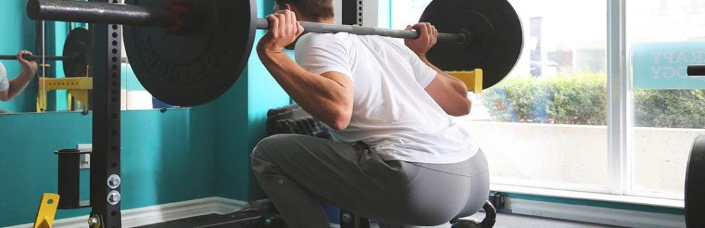 Man squatting - Leg Press Machines