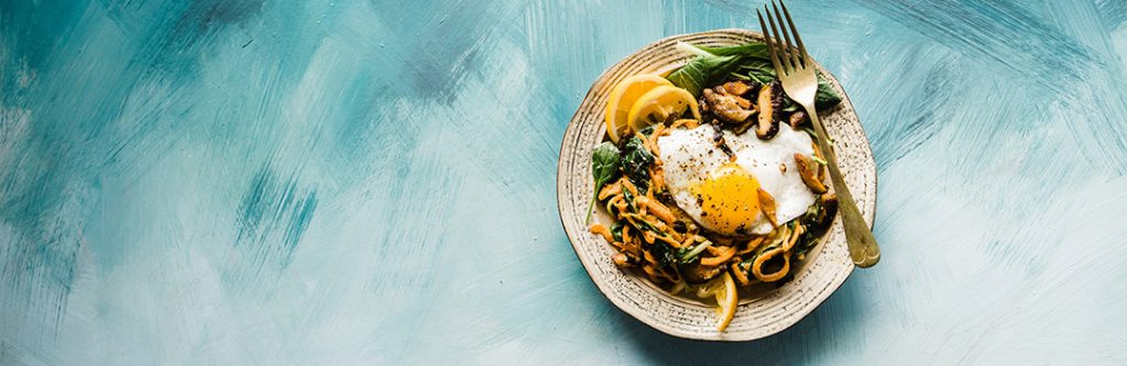 A paleo-friendly dish with eggs, mushrooms, and greens